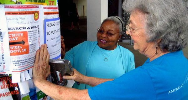 AAUW members in Florida post get out the vote posters in their community.
