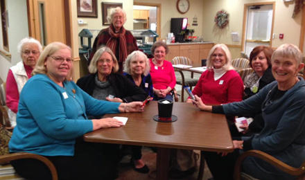AAUW of Algona (IA) Branch members practice for the Iowa caucuses with candies instead of candidates