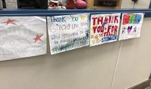 Photograph of hand-drawn thank you signs for school cafeteria workers from students.